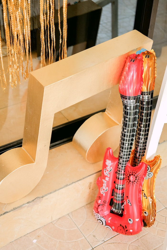Inflatable guitars and giant music note from a Beatles Birthday Party on Kara's Party Ideas | KarasPartyIdeas.com (6)
