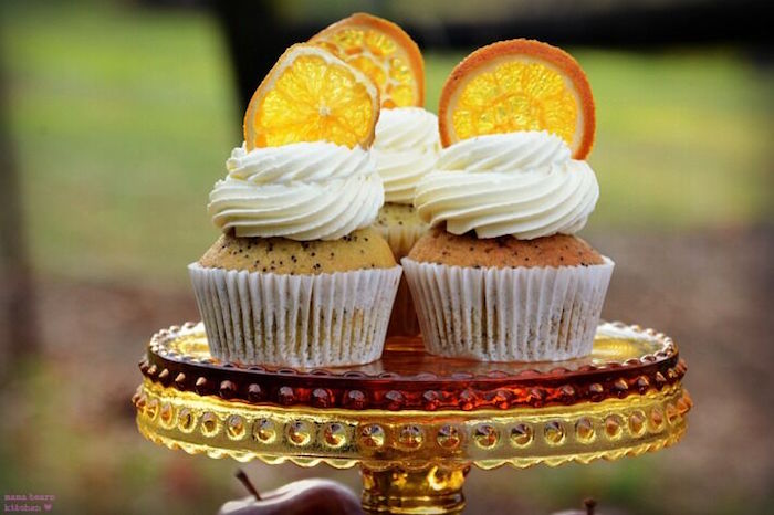 Poppy seed cupcakes topped with orange slices from a Fall Dessert Table on Kara's Party Ideas | KarasPartyIdeas.com (7)