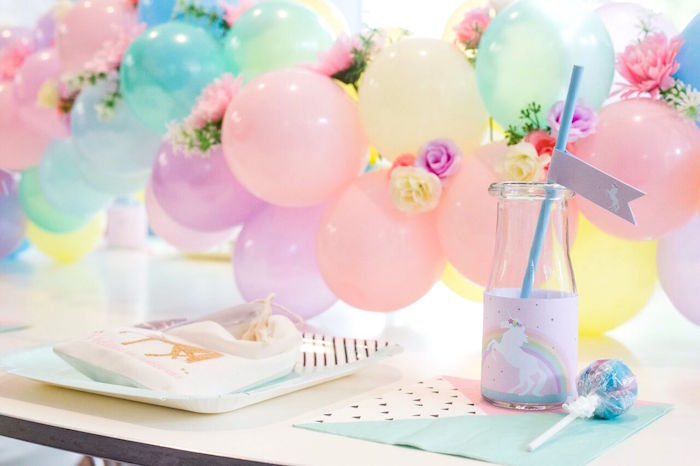 Unicorn drink bottle + floral pastel ballon garland from a Floral Rainbow Glam Unicorn Birthday Party on Kara's Party Ideas | KarasPartyIdeas.com (6)