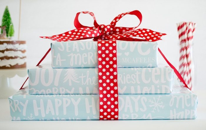 Wrapped stack of gifts tied with ribbon from a Holiday Pajama Party on Kara's Party Ideas | KarasPartyIdeas.com (12)
