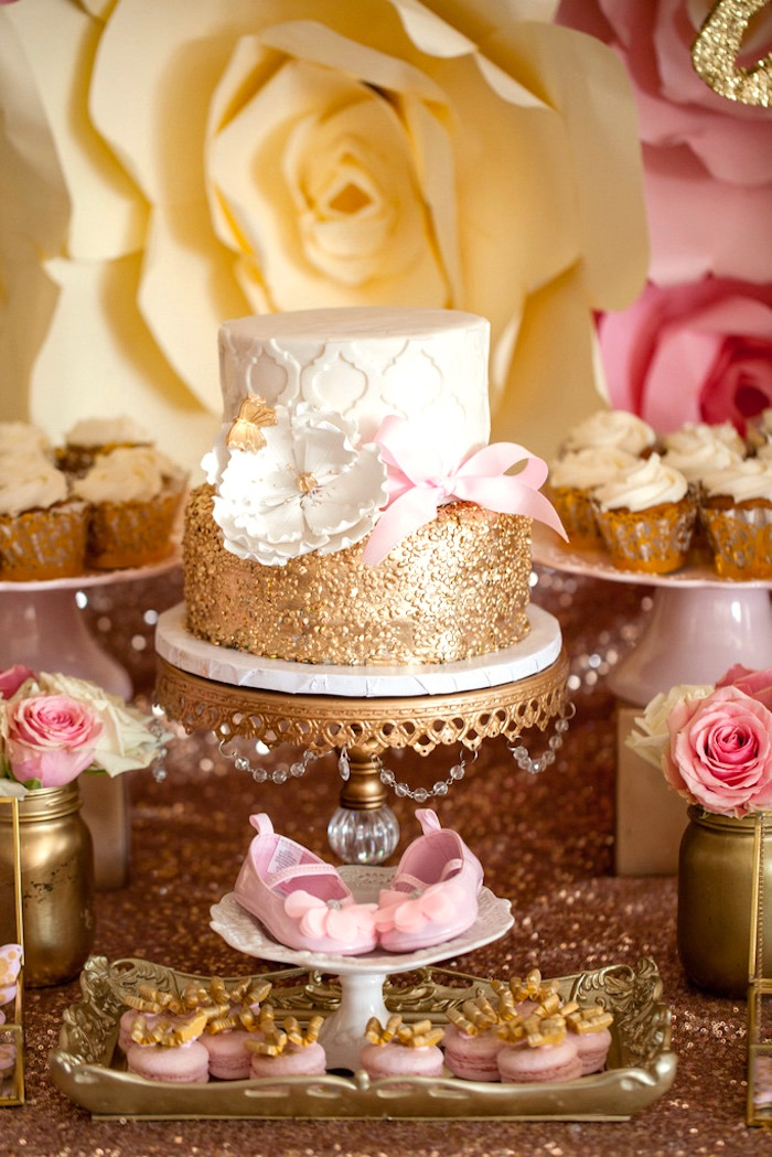 gorgeous gold and white cake from a pink gold butterfly baby shower