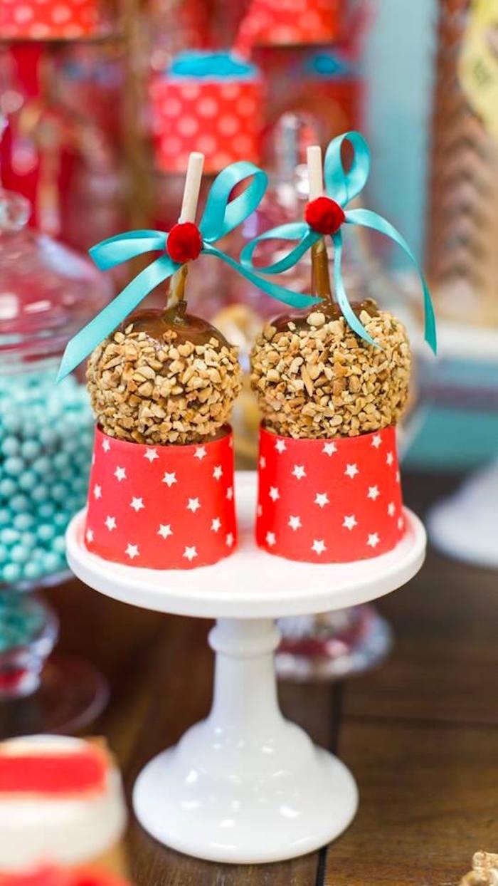Caramel apples atop circus pedestals from a Vintage Circus Birthday Party on Kara's Party Ideas | KarasPartyIdeas.com (3)