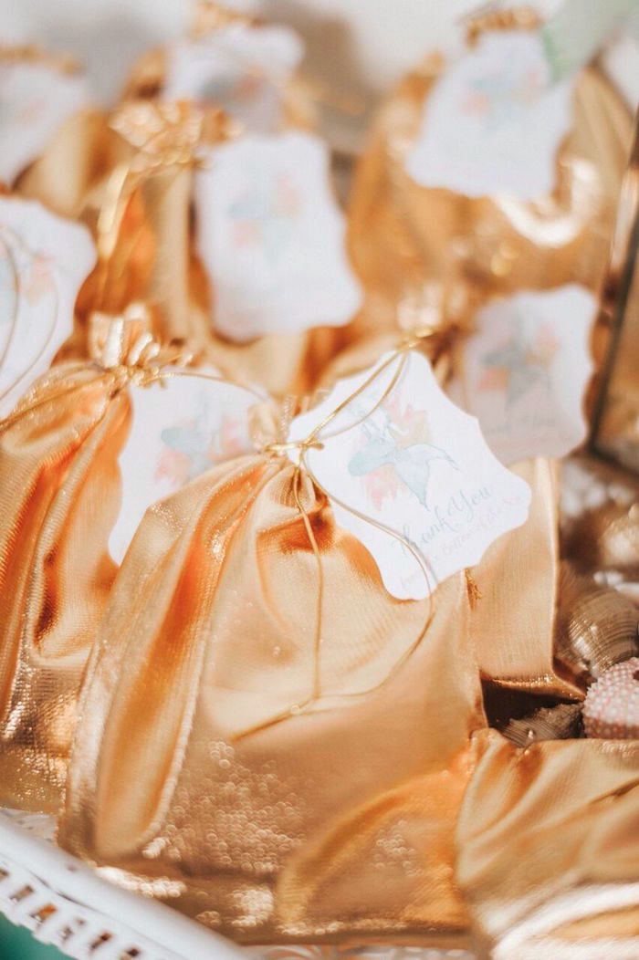 Gold drawstring favor bags with mermaid tags from a Whimsical Mermaid Birthday Party on Kara's Party Ideas | KarasPartyIdeas.com (31)