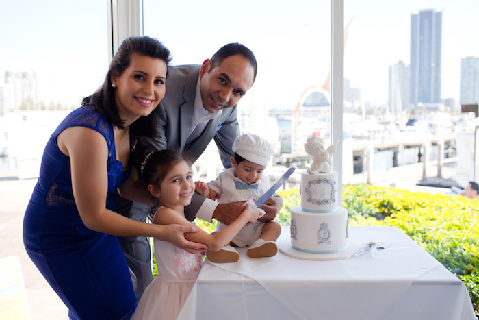 Cutting the cake at a White & Blue Christening Celebration on Kara's Party Ideas | KarasPartyIdeas.com (4)