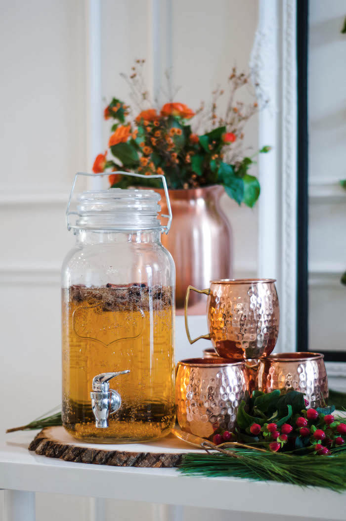 Beverage dispenser with brass mugs from a Cozy Winter Party on Kara's Party Ideas | KarasPartyIdeas.com (41)