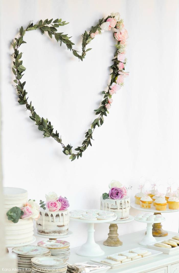 Flower heart backdrop hanging. Floral chic baby blessing luncheon by Kara Allen | Kara's Party Ideas LDS Blessing Ideas with FREE printables