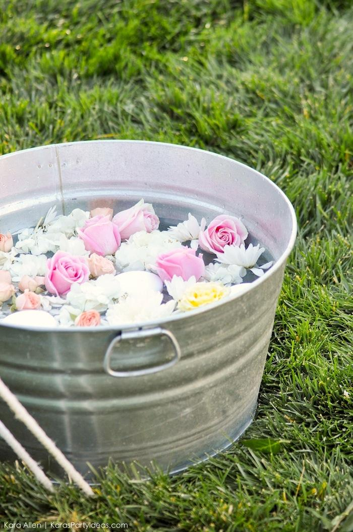 Floating flowers in galvanized tub at a floral chic baby blessing luncheon by Kara Allen | Kara's Party Ideas LDS Blessing Ideas with FREE printables