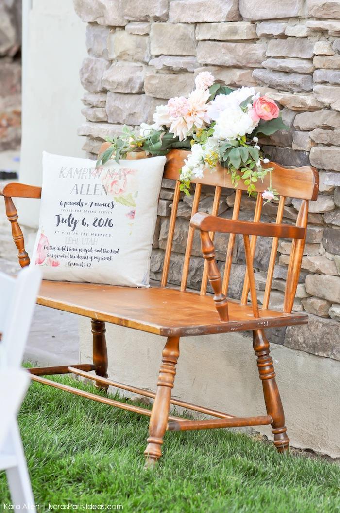Wooden bench with personalized pillow. Floral chic baby blessing luncheon by Kara Allen | Kara's Party Ideas LDS Blessing Ideas with FREE printables