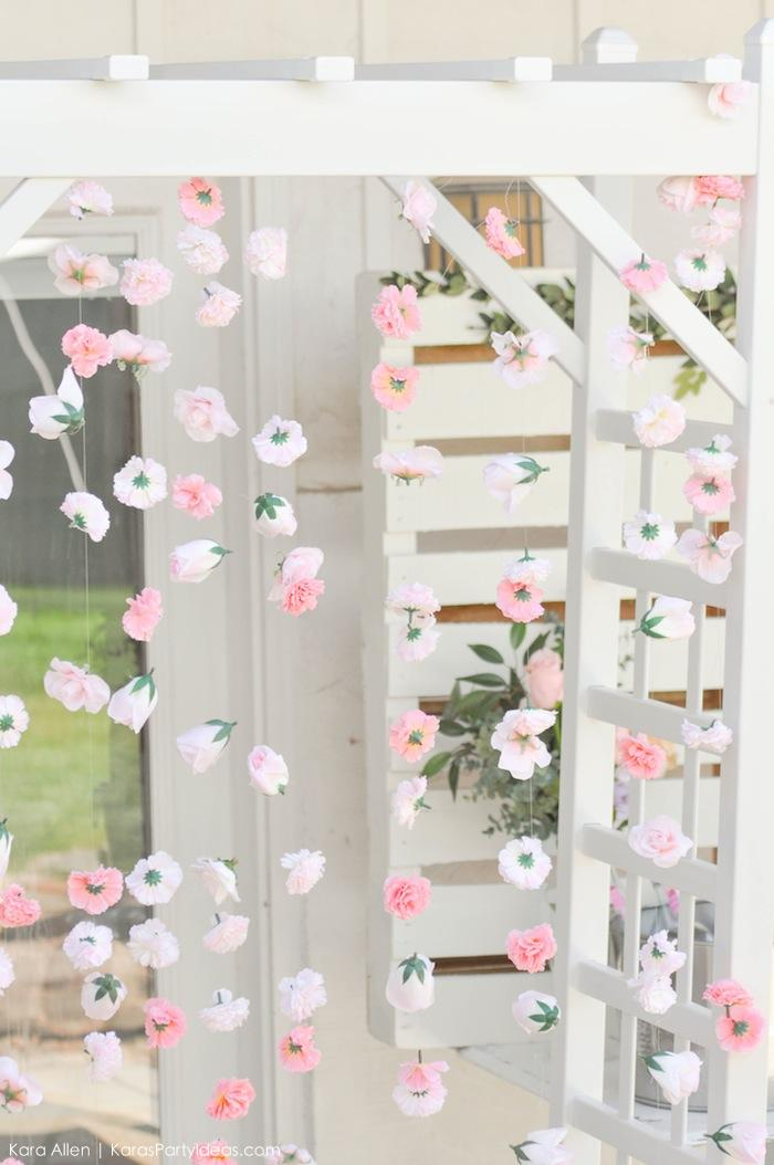Strung hanging flower backdrop at a floral chic baby blessing luncheon by Kara Allen | Kara's Party Ideas LDS Blessing Ideas with FREE printables