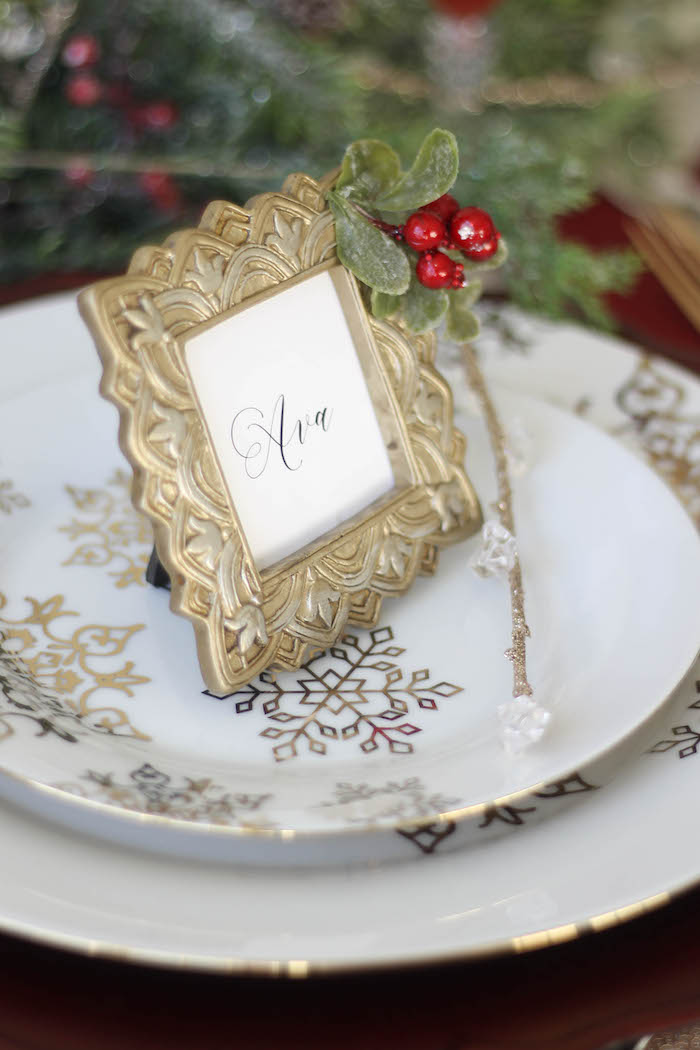Antique gold place card frame adorned with cranberries and boxwood stems from a Holly & Ivy Holiday Dinner Party on Kara's Party Ideas | KarasPartyIdeas.com (20)
