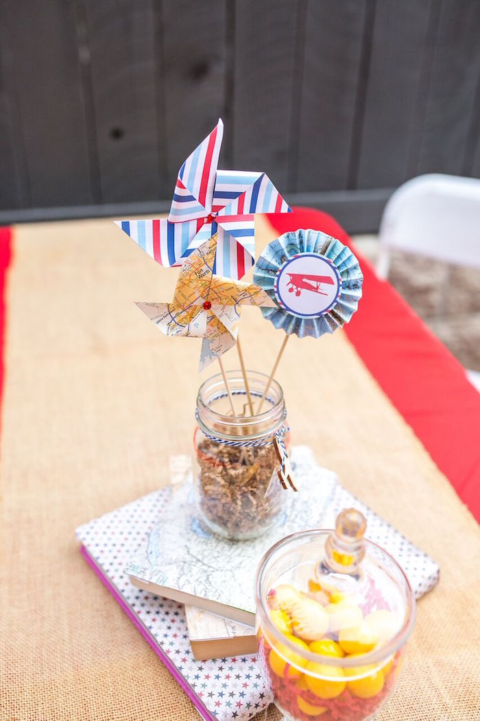 Karas Party Ideas Pinwheel centerpiece from a Vintage Airplane
