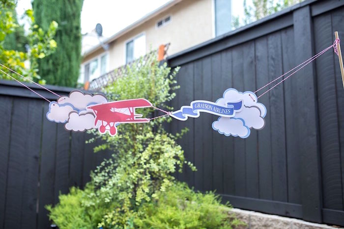 Airplane in the clouds banner from a Vintage Airplane Birthday Party on Kara's Party Ideas | KarasPartyIdeas.com (52)