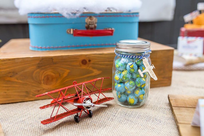 Globe chocolates in a jar from a Vintage Airplane Birthday Party on Kara's Party Ideas | KarasPartyIdeas.com (29)