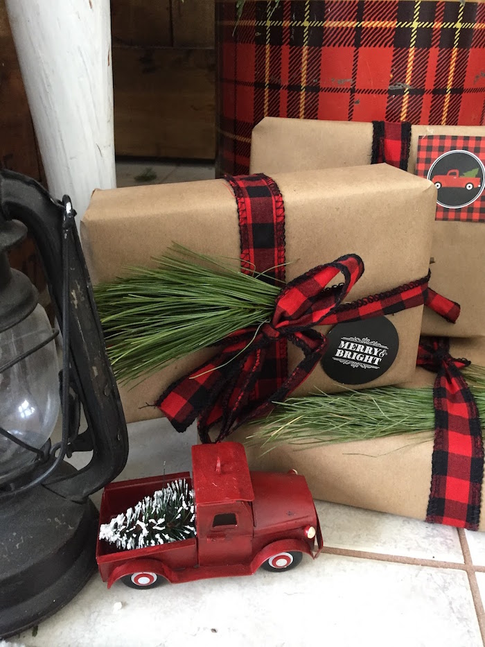 Plaid and sprig wrapped gift from a Vintage Rustic Plaid Christmas Party on Kara's Party Ideas | KarasPartyIdeas.com (24)