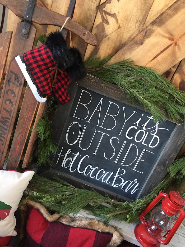Chalkboard sign adorned with pine sprigs from a Vintage Rustic Plaid Christmas Party on Kara's Party Ideas | KarasPartyIdeas.com (5)