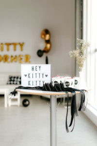 Lightbox sign with kitty cat ear favors from a Black & White Kitty Birthday Party on Kara's Party Ideas | KarasPartyIdeas.com (7)