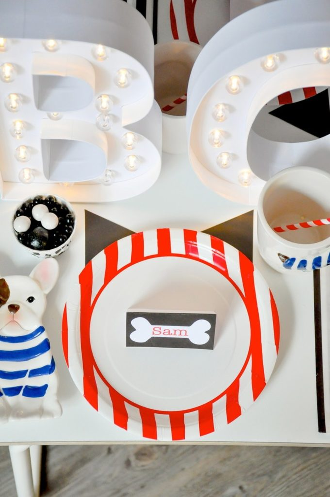 Pointed dog ears behind the plate! Modern French Bulldog and Friends dog birthday party by Karas Party Ideas | KarasPartyIdeas.com with FREE PRINTABLE PLACE CARDS, TAGS, BACKDROP, SIGNS AND MORE!