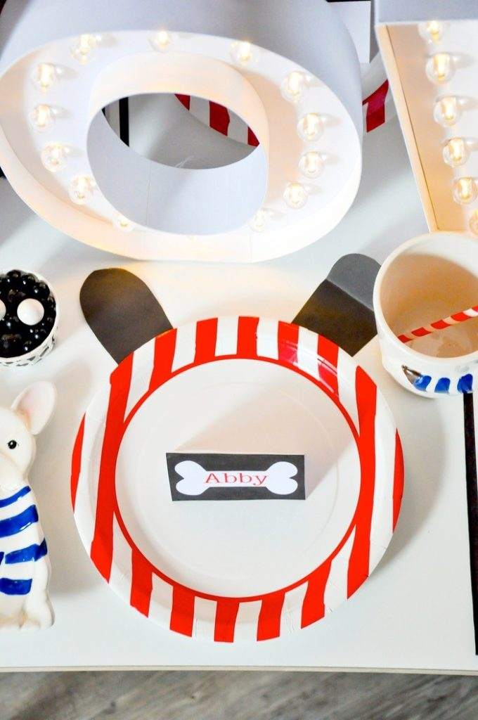 Cute idea! Dog ears behind the plate! Modern French Bulldog and Friends dog birthday party by Karas Party Ideas | KarasPartyIdeas.com with FREE PRINTABLE PLACE CARDS, TAGS, BACKDROP, SIGNS AND MORE!