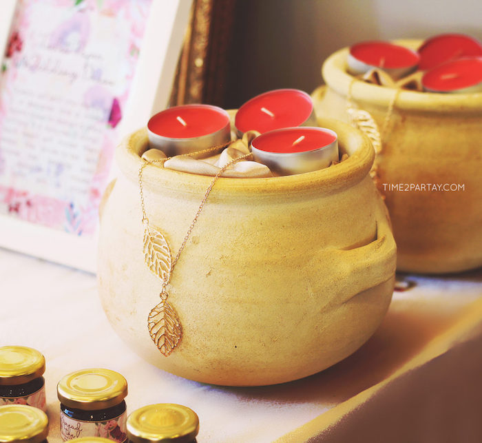 Greek style vase filled with berry scented candles from a Floral Greek Bridal Shower on Kara's Party Ideas | KarasPartyIdeas.com (5)