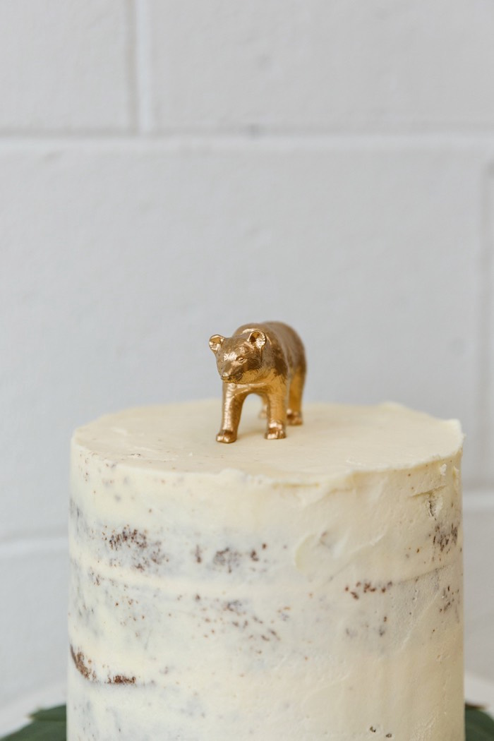 Cake topped with a gold bear topper from a Modern + Rustic 1st Birthday Party on Kara's Party Ideas | KarasPartyIdeas.com (24)