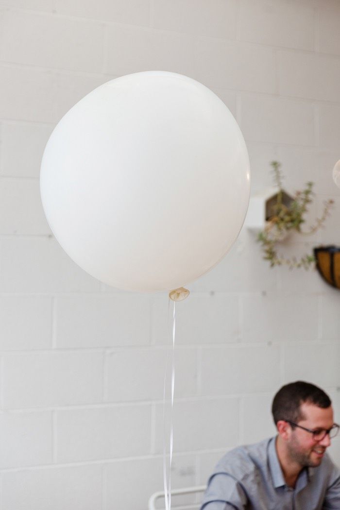 Oversized white balloon from a Modern + Rustic 1st Birthday Party on Kara's Party Ideas | KarasPartyIdeas.com (15)