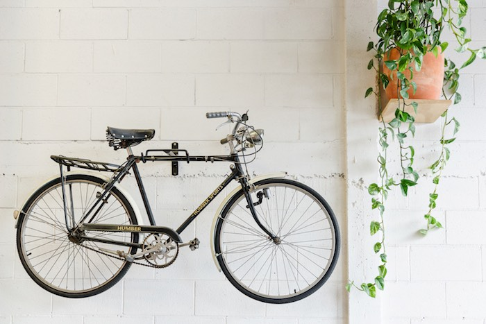 Bicycle hanging on a wall at a Modern + Rustic 1st Birthday Party on Kara's Party Ideas | KarasPartyIdeas.com (35)