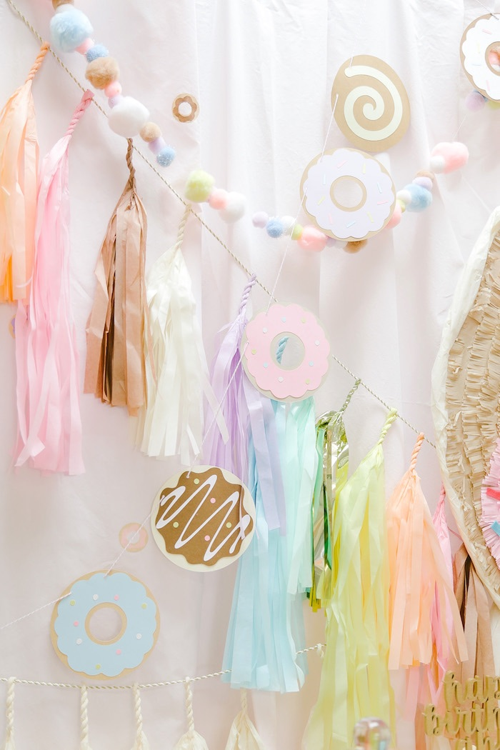 Pastel bunting + donut banner from a Tissue tassel garland from a Pastel Donut Birthday Party on Kara's Party Ideas | KarasPartyIdeas.com (15)