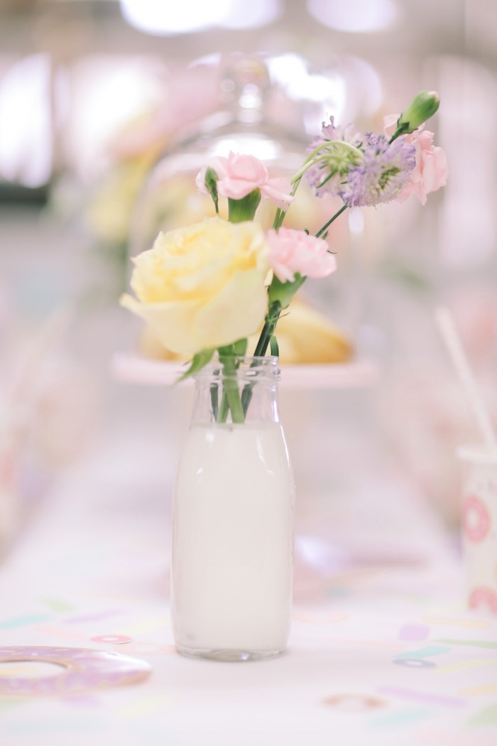 Milk & flower centerpiece from a Pastel Donut Birthday Party on Kara's Party Ideas | KarasPartyIdeas.com (11)
