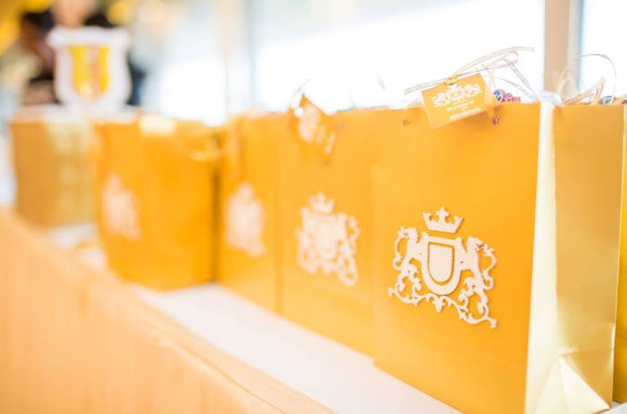 Favor bags adorned with royal crests from a Royal Prince 1st Birthday Party on Kara's Party Ideas | KarasPartyIdeas.com (16)
