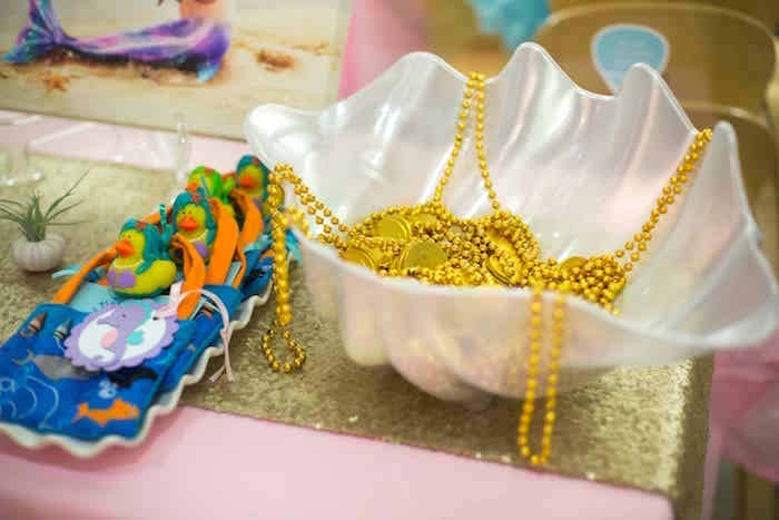 Seashell of beaded gold necklaces from a Shimmering Mermaid Birthday Party on Kara's Party Ideas | KarasPartyIdeas.com (23)