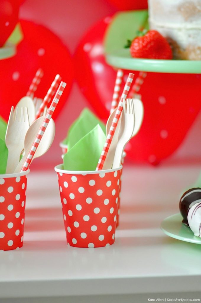 Strawberry cups with napkins and utensils. Berry Sweet Strawberry Valentine's Day Party with FREE printables! By Kara's Party Ideas for Canon.