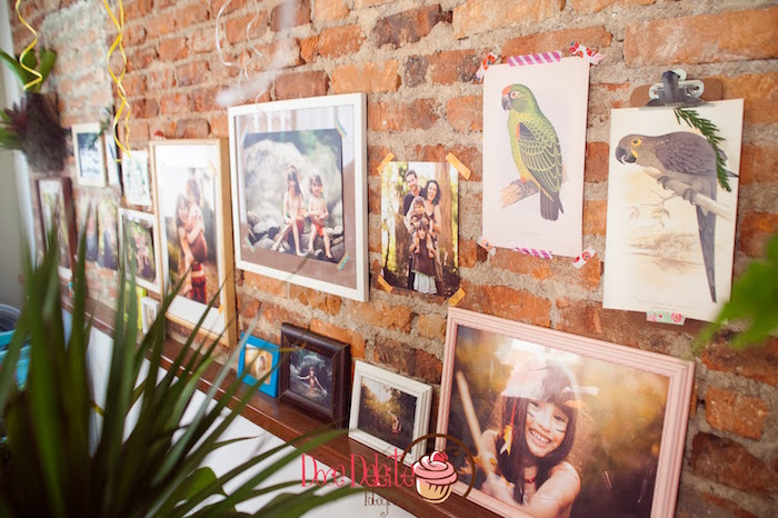 Rustic brick backdrop adorned with framed prints from a Print wall backdrop from a Taina Inspired Little Indian Birthday Party on Kara's Party Ideas | KarasPartyIdeas.com (22)