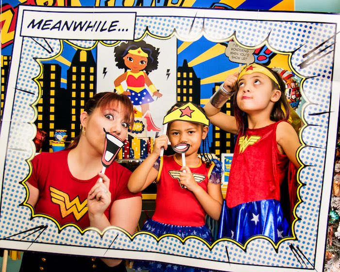 Superhero photo booth from a Wonder Woman Superhero Birthday Party on Kara's Party Ideas | KarasPartyIdeas.com (11)