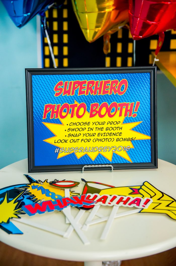 Superhero photo booth from a Wonder Woman Superhero Birthday Party on Kara's Party Ideas | KarasPartyIdeas.com (10)