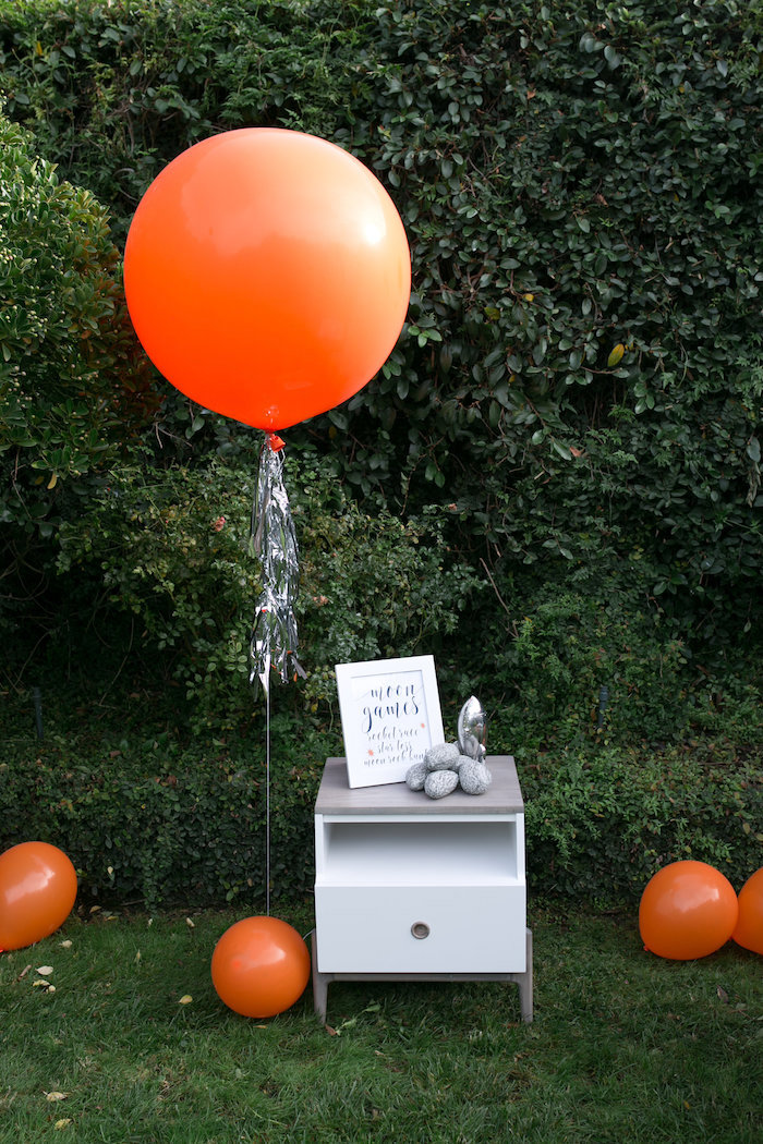 """Orange jumbo balloon with silver tassel tail from a """"Fly Me to the Moon"""" Joint Birthday Party on Kara's Party Ideas 