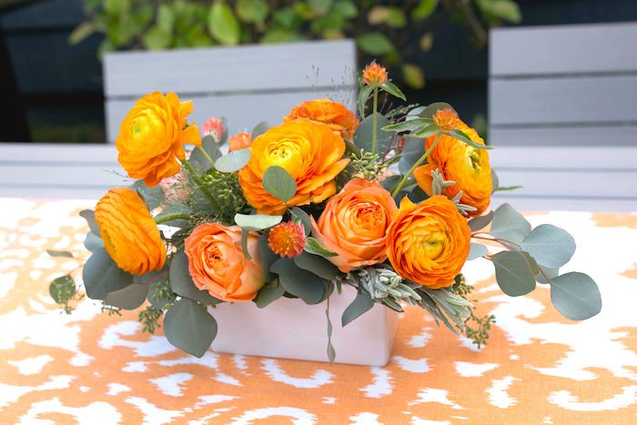 """Orange flower centerpiece from a """"Fly Me to the Moon"""" Joint Birthday Party on Kara's Party Ideas 