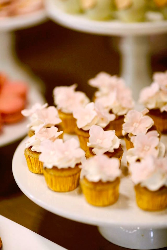 Cupcakes topped with sugar flowers from a Glamorous Unicorn Christening Party on Kara's Party Ideas | KarasPartyIdeas.com (9)