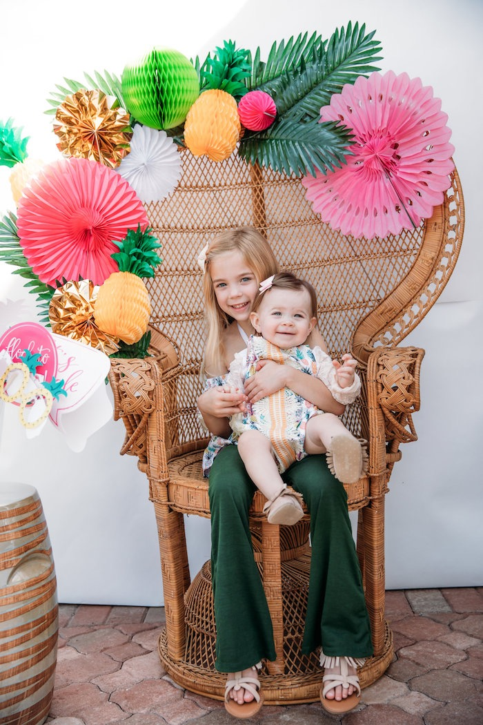 Party chair adorned with tissue decorations from a Party Like a Pineapple Tropical Birthday Party on Kara's Party Ideas | KarasPartyIdeas.com (12)