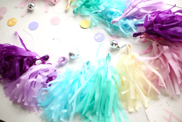 Tissue tassel garland from a Pastel Unicorn Birthday Party on Kara's Party Ideas | KarasPartyIdeas.com (3)