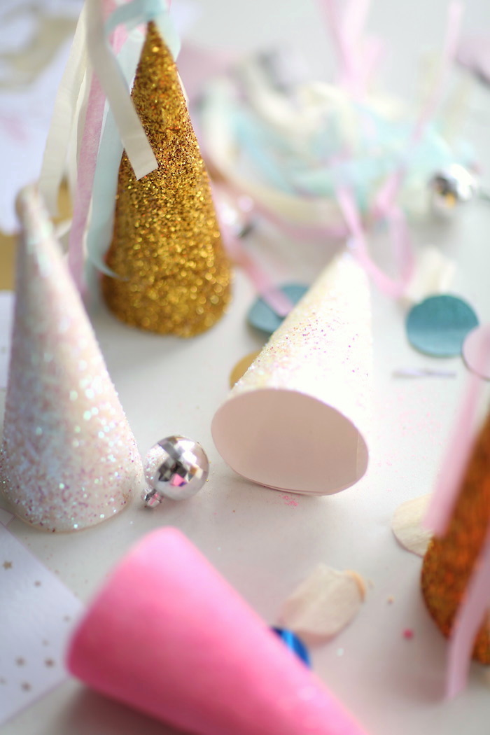Unicorn horn party hats from a Pastel Unicorn Birthday Party on Kara's Party Ideas | KarasPartyIdeas.com (12)