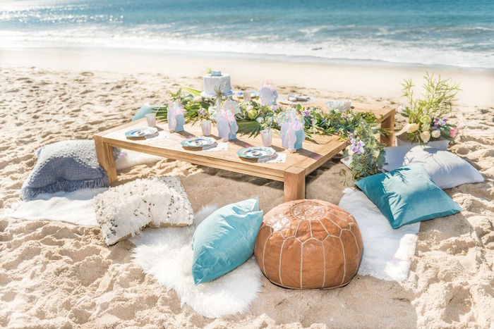 Beachside guest table with pillow seating from a Seaside Mermaid Party on Kara's Party Ideas | KarasPartyIdeas.com (26)