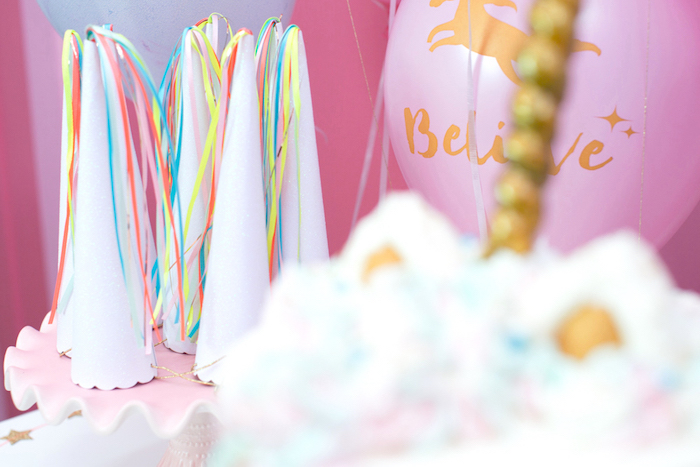 "Unicorn horn party hats from a ""Unicorns are Real"" Birthday Party on Kara's Party Ideas 