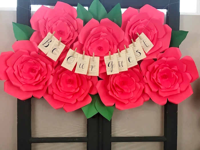 "Be Our Guest paper rose backdrop from a ""Be Our Guest"" Beauty and the Beast Party on Kara's Party Ideas 