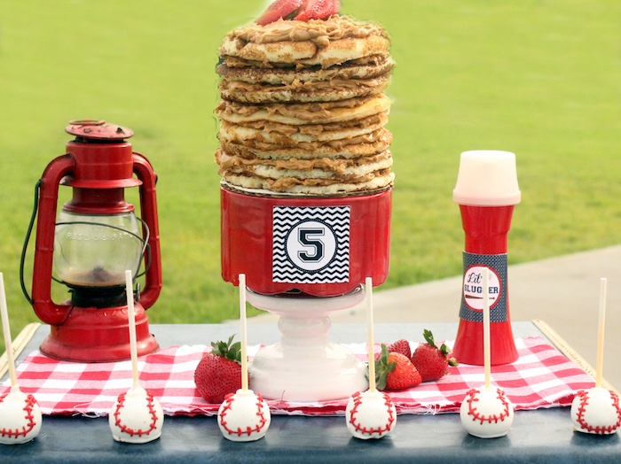 "Stacked cookie cake and baseball cake pops from a ""Slugger Sleepover"" Baseball Birthday Party on Kara's Party Ideas 
