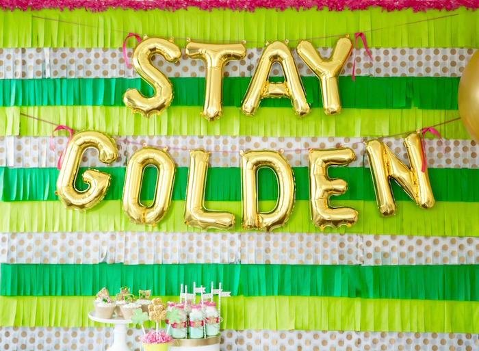 "Green + gold fringe tassel backdrop from a ""Stay Golden"" St. Patrick's Day Party on Kara's Party Ideas 