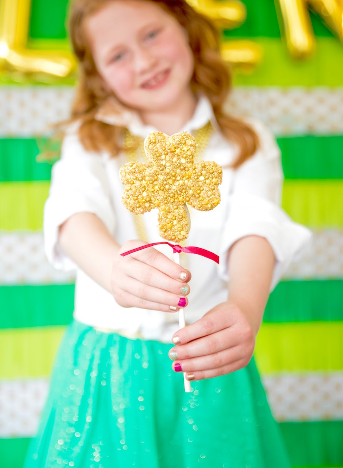 "Gold 4-Leaf Clover cookie pop from a ""Stay Golden"" St. Patrick's Day Party on Kara's Party Ideas 