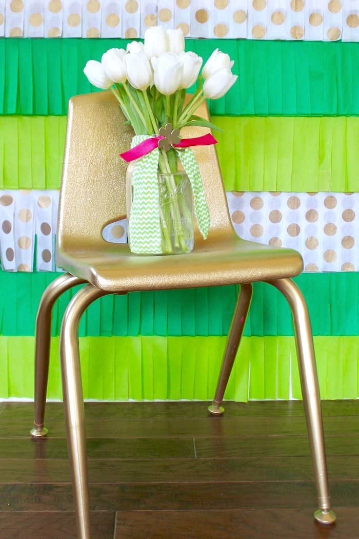 "Gold chair with blooms from a ""Stay Golden"" St. Patrick's Day Party on Kara's Party Ideas 