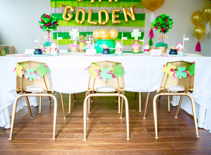 "Gold chairs with shamrock ties from a ""Stay Golden"" St. Patrick's Day Party on Kara's Party Ideas 