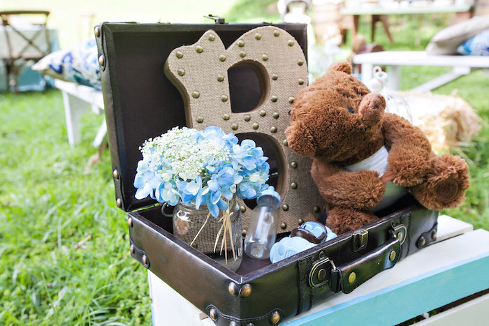 Suitcase full of decor from a Bottles and Burlap Baby Shower on Kara's Party Ideas | KarasPartyIdeas.com (39)