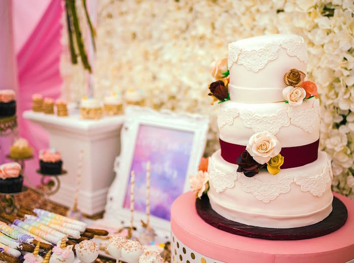 White cake adorned with flowers from a Burgundy & Blush Unicorn Baby Shower on Kara's Party Ideas | KarasPartyIdeas.com (6)